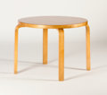 Furniture : Continental, ALVAR AALTO. A Round Laminated Birch Occasional Table. 27 x 39inches (68.6 x 99.1 cm). ...