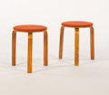 Furniture , ALVAR AALTO. A Pair of Upholstered Laminated Birch Low Stools. 17-1/2 x 13-1/2 inches (44.5 x 34.3 cm) each...