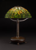"""Decorative Arts, American:Lamps & Lighting, PROPERTY FROM A FLORIDA COLLECTION. TIFFANY STUDIOS. A """"Daffodil"""" Leaded Glass and Bronze Table Lamp, circa 1910. Base sta..."""