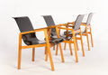 Furniture : Continental, ALVAR AALTO. Four Laminated Birch Paimio Chairs, model no. 51,circa 1930s, and A Square Laminated Birch Occasional Table wi...