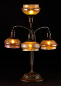 Decorative Arts, American:Lamps & Lighting, PROPERTY FROM A FLORIDA COLLECTION. TIFFANY STUDIOS. A Bronze and Favrile Glass Four-Light Twisted Newel Post Lamp, circa ... (Total: 5 Items)