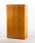 Furniture : English, GERALD SUMMERS FOR HEALS. A Sycamore Wardrobe, circa 1930. Marks: bearing decal. 70 x 39 x 20 inches (177.8 x 99.1 x 50.8 cm...