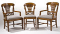 Furniture : French, ANDRE GROULT. A Set of Ten Carved Walnut Dining Chairs, includingeight side chairs and two armchairs. Marks: stamped Andr...