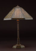 """Lighting:Lamps, PROPERTY OF A CALIFORNIA COLLECTOR. TIFFANY STUDIOS. A """"Chippendale"""" Bronze and Favrile Glass Table Lamp, circa 1910. Base..."""