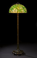 """Decorative Arts, American:Lamps & Lighting, PROPERTY OF A NEW YORK FAMILY. TIFFANY STUDIOS. A """"Bamboo"""" Leaded Glass and Bronze Floor Lamp, circa 1910. Piano lamp base..."""