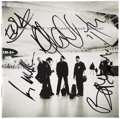 Music Memorabilia:Autographs and Signed Items, U2 Band-Signed CD Liner Notes....
