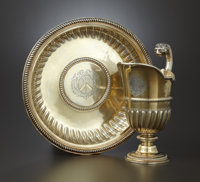 A GEORGE I SILVER GILT EWER AND BASIN Paul de Lamerie, London, England, 1714-1716 Marks: (lion's head erased)