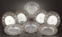 A SET OF EIGHT AMERICAN SILVER PLATES Attributed to Dominick & Haff, New York, New York, circa 1890 Marks: S