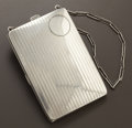 Silver Smalls:Other , AN AMERICAN SILVER COMPACT ON CHAIN. Maker unknown, circa 1940.Marks: W. STERLING, 741. 3-3/4 x 2-1/2 x 0-3/8 inches (9...