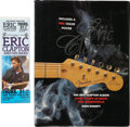 Music Memorabilia:Autographs and Signed Items, Eric Clapton Signed Book and Ticket.... (Total: 2 Items)