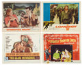 Movie/TV Memorabilia:Autographs and Signed Items, Glenn Ford, Kirk Douglas, Robert Mitchum, and Charlton Heston Signed Lobby Cards.... (Total: 4 Items)