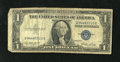 Error Notes:Skewed Reverse Printing, Fr. 1614 $1 1935E Silver Certificate. Very Good-Fine.. ...