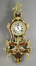 Furniture: French, A French Louis XV Style Tortoiseshell and Gilt Bronze Bracket Clock. Unknown maker, France. Mid Nineteenth Century. Tortoi...