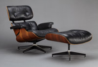 AN AMERICAN ROSEWOOD AND BLACK LEATHER CHAIR AND OTTOMAN Designed by Charles and Ray Eames, 1957 Produced by