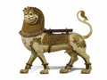Asian:Other, An Indian Painted Gilt Wood Standing Lion. Unknown maker, India.20th century. Carved and painted wood, glass and wrought ...