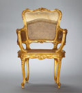 Furniture : French, A FRENCH LOUIS XV-STYLE CARVED AND GILT CANED ARMCHAIR . French,circa 1900. Unmarked. 35-3/4 x 24 x 19 inches (90.8 x 61.0 ...