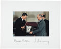 "Autographs:U.S. Presidents, Ronald Reagan and Mikhail Gorbachev Photo Signed. The photograph(6"" x 4"") is mounted to white paperboard (10"" x 8""). Accord..."