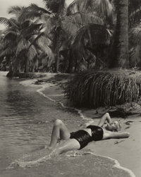 PHILIPPE HALSMAN (American, 1906-1979) Untitled (Girl Lying on Beach), circa 1940s Gelatin silver, p