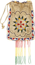 American Indian Art:Beadwork and Quillwork, AN APACHE BEADED HIDE DRAWSTRING POUCH. c. 1900...