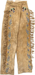 American Indian Art:Baskets, A PAIR OF PLAINS BEADED HIDE TROUSERS. c. 1890...