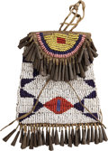 American Indian Art:Beadwork and Quillwork, AN ARAPAHO BEADED HIDE STRIKE-A-LIGHT POUCH. c. 1880...
