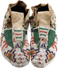 American Indian Art:Beadwork and Quillwork, A PAIR OF SIOUX BEADED HIDE CEREMONIAL MOCCASINS. c. 1885...(Total: 2 Items)