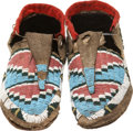 American Indian Art:Beadwork and Quillwork, A PAIR OF SIOUX BEADED BUFFALO HIDE MOCCASINS. c. 1875... (Total: 2Items)