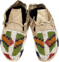 American Indian Art:Beadwork and Quillwork, A PAIR OF PLAINS CHILD'S BEADED HIDE MOCCASINS. c. 1900... (Total:2 Items)