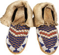 American Indian Art:Beadwork and Quillwork, A PAIR OF PLAINS CHILD'S BEADED HIDE MOCCASINS. c. 1900... (Total: 2 Items)