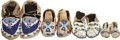 American Indian Art:Beadwork and Quillwork, THREE PAIRS OF PLAINS CHILD'S BEADED HIDE MOCCASINS. c. 1890...(Total: 8 Items)