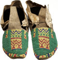 American Indian Art:Beadwork and Quillwork, A PAIR OF NORTHERN ARAPAHO BEADED HIDE MOCCASINS. c. 1885...(Total: 2 Items)