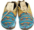 Other, A PAIR OF NORTHERN ARAPAHO BEADED AND QUILLED HIDE MOCCASINS. c. 1885... (Total: 2 Items)