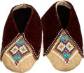 American Indian Art:Beadwork and Quillwork, A PAIR OF KICKAPOO BEADED HIDE MOCCASINS. c. 1880... (Total: 2Items)