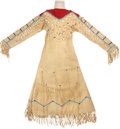American Indian Art:Beadwork and Quillwork, A CROW GIRL'S BEADED HIDE DRESS. c. 1940...