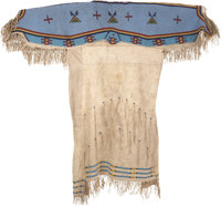 A SIOUX BEADED AND FRINGED HIDE DRESS c. 1885