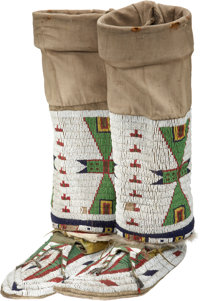 A PAIR OF SIOUX BEADED HIDE MOCCASINS AND MATCHED LEGGINGS c. 1890