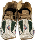 American Indian Art:Beadwork and Quillwork, A PAIR OF CHEYENNE BEADED HIDE MOCCASINS. c. 1890... (Total: 2Items)
