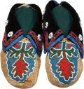 American Indian Art:Beadwork and Quillwork, A PAIR OF CADDO/DELAWARE BEADED HIDE MOCCASINS. c. 1900... (Total:2 Items)