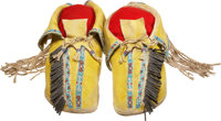 A PAIR OF COMANCHE BEADED HIDE MOCCASINS c. 1890