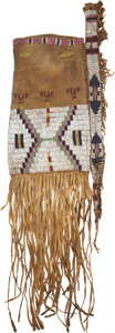 American Indian Art:Beadwork and Quillwork, A UTE BEADED BUFFALO HIDE TOBACCO BAG. c. 1870...