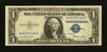 Error Notes:Skewed Reverse Printing, Fr. 1614 $1 1935E Silver Certificate. Very Fine.. ...