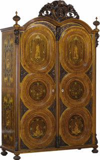 A Pair of Mid-Nineteenth Century German Walnut Veneered Marquetry Wardrobes With Applied Carvings  John Falcona