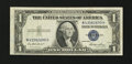 Error Notes:Skewed Reverse Printing, Fr. 1614 $1 1935E Silver Certificate. Extremely Fine.. ...