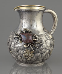 AN AMERICAN SILVER, SILVER GILT AND MIXED METAL PITCHER Whiting Manufacturing Company, New York, New York, circa