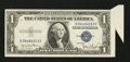 Error Notes:Attached Tabs, Fr. 1613N $1 1935D Silver Certificate. Extremely Fine.. ...