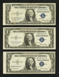 Error Notes:Error Group Lots, Fr. 1614 $1 1935E Silver Certificates. Three Examples- AU, EF-AU,and VF.. ... (Total: 3 notes)