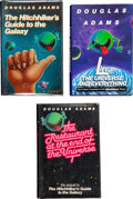Books:Signed Editions, Douglas Adams. Three Signed First Editions, including: The Hitchhiker's Guide to the Galaxy. New York: Harmony Books... (Total: 3 Items)