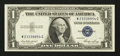 Error Notes:Skewed Reverse Printing, Fr. 1614 $1 1935E Silver Certificate. About Uncirculated.. ...