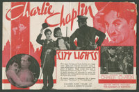 "City Lights Lot (United Artists, 1931). Herald (6"" X 9"" Folded Out) and Photos (3) (8"" X 10""). Comed..."