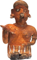 Antiques:Antiquities, Seated Female Figure Holding a Rattle...